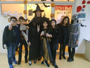 teacher with students in Halloween costumes