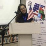 Kamilla at the podium