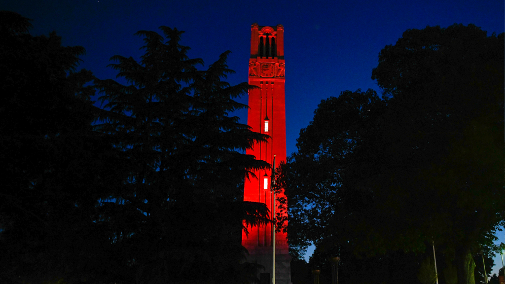The belltower is light in red at night.