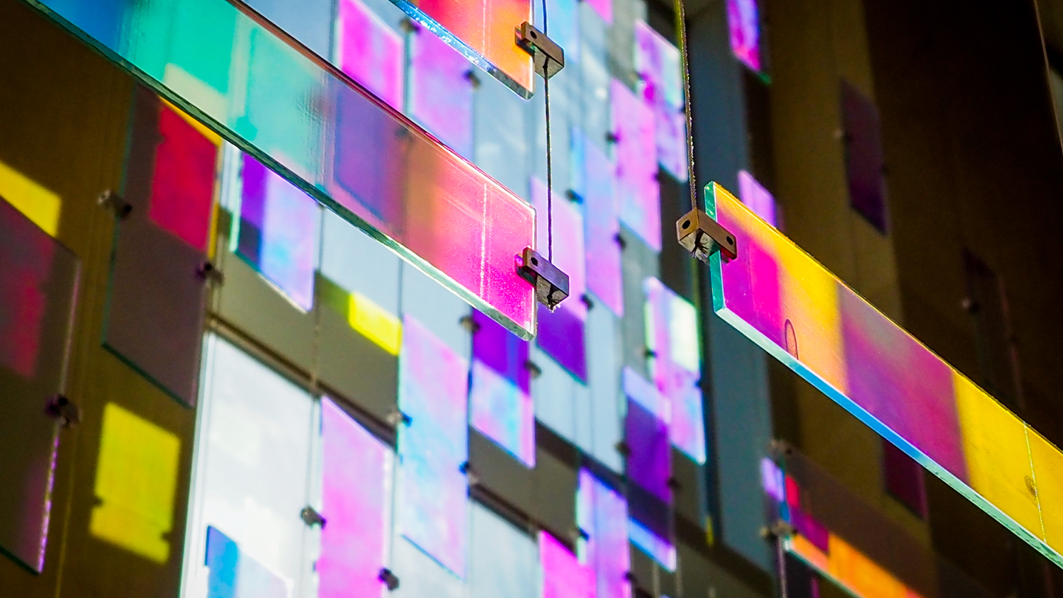 Light streams through stained glass blocks in the DH Hill