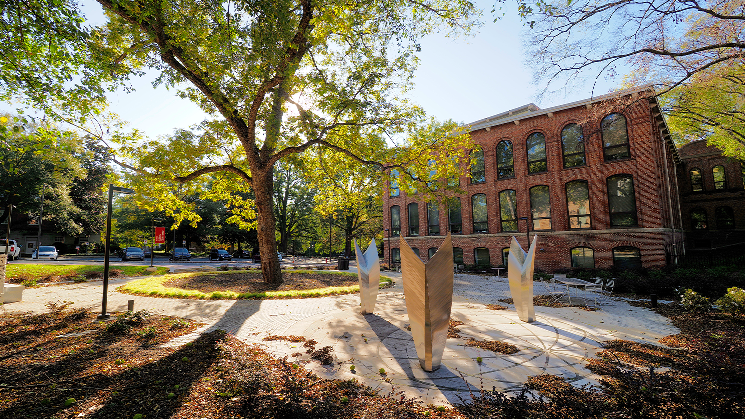 Global courtyard in the fall with leaves on the ground.