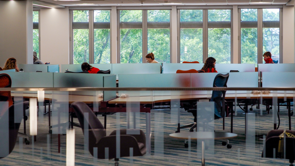 Students work in the newly renovated DH Hill Library on the first day of classes for the fall 2020 semester.