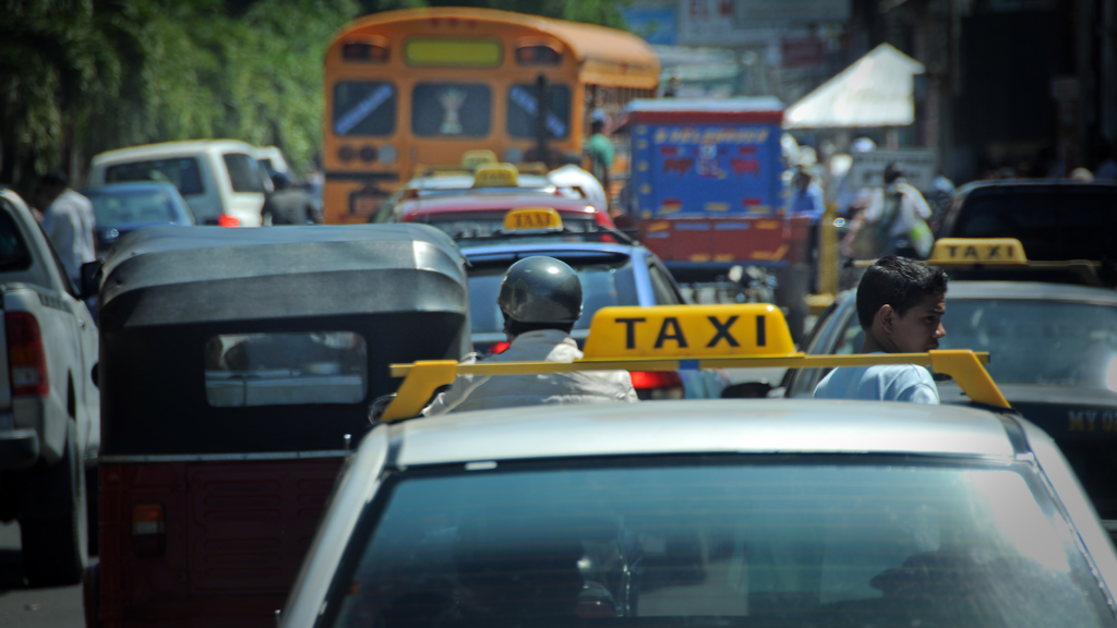 A taxi stuck in traffic.